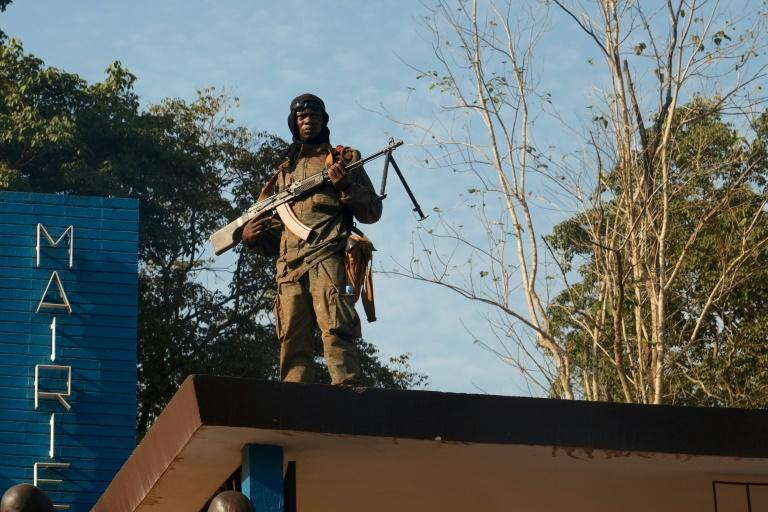 A Central African Republic army guards the town hall of Bambari which was rocked by violence recently