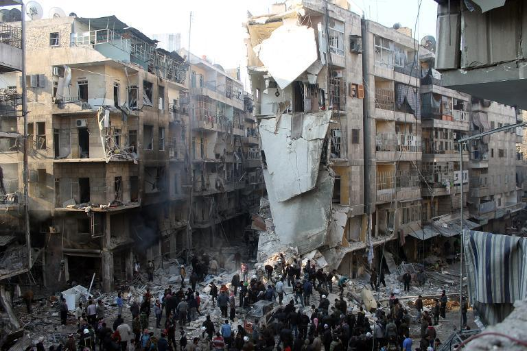 People search for survivors amidst the rubble following an airstrike in the Shaar neighborhood of Aleppo on December 17, 2013