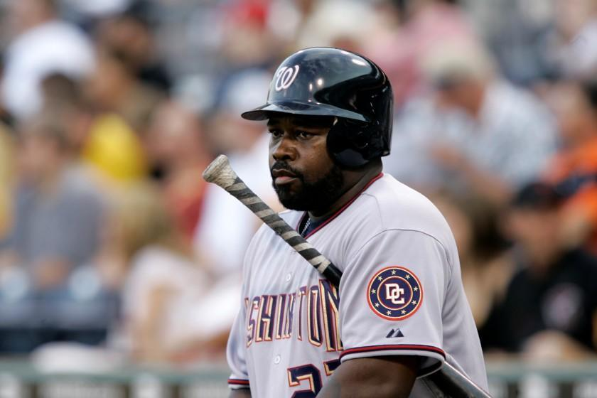 Washington Nationals' Dmitri Young warms up on deck against the Pittsburgh Pirates in a baseball game at Pittsburgh Tuesday, June 10, 2008. (AP Photo/Gene J. Puskar)