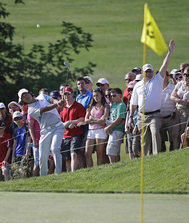 Hideki Matsuyama, front left, of Japan, chips to the 18th green during a playoff at the Memorial golf tournament Sunday, June 1, 2014, in Dublin, Ohio. Matsuyama defeated Kevin Na to win the tournament. (AP Photo/Darron Cummings)