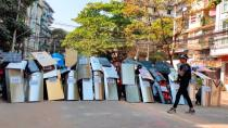 Protesters set up a makeshift shield formation in preparation for potential clashes, in Yangon
