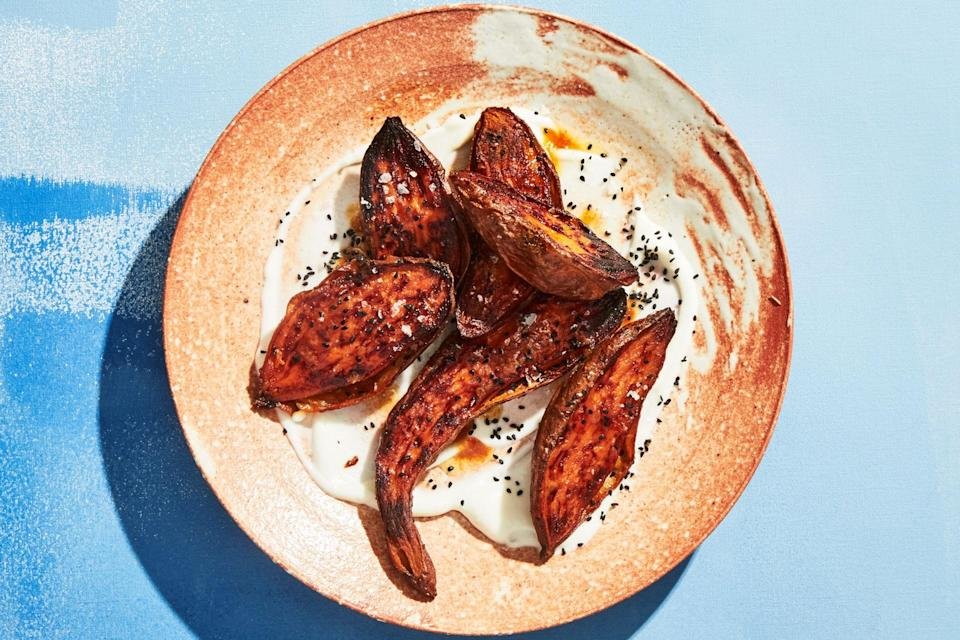 "This recipe is nice twice. The roasting and honey-glazing method is a great way to make sweet potatoes, and you also get an eggless garlic sauce that you'll use again and again. <a href=""https://www.epicurious.com/recipes/food/views/charred-sweet-potatoes-with-toum?mbid=synd_yahoo_rss"" rel=""nofollow noopener"" target=""_blank"" data-ylk=""slk:See recipe."" class=""link rapid-noclick-resp"">See recipe.</a>"