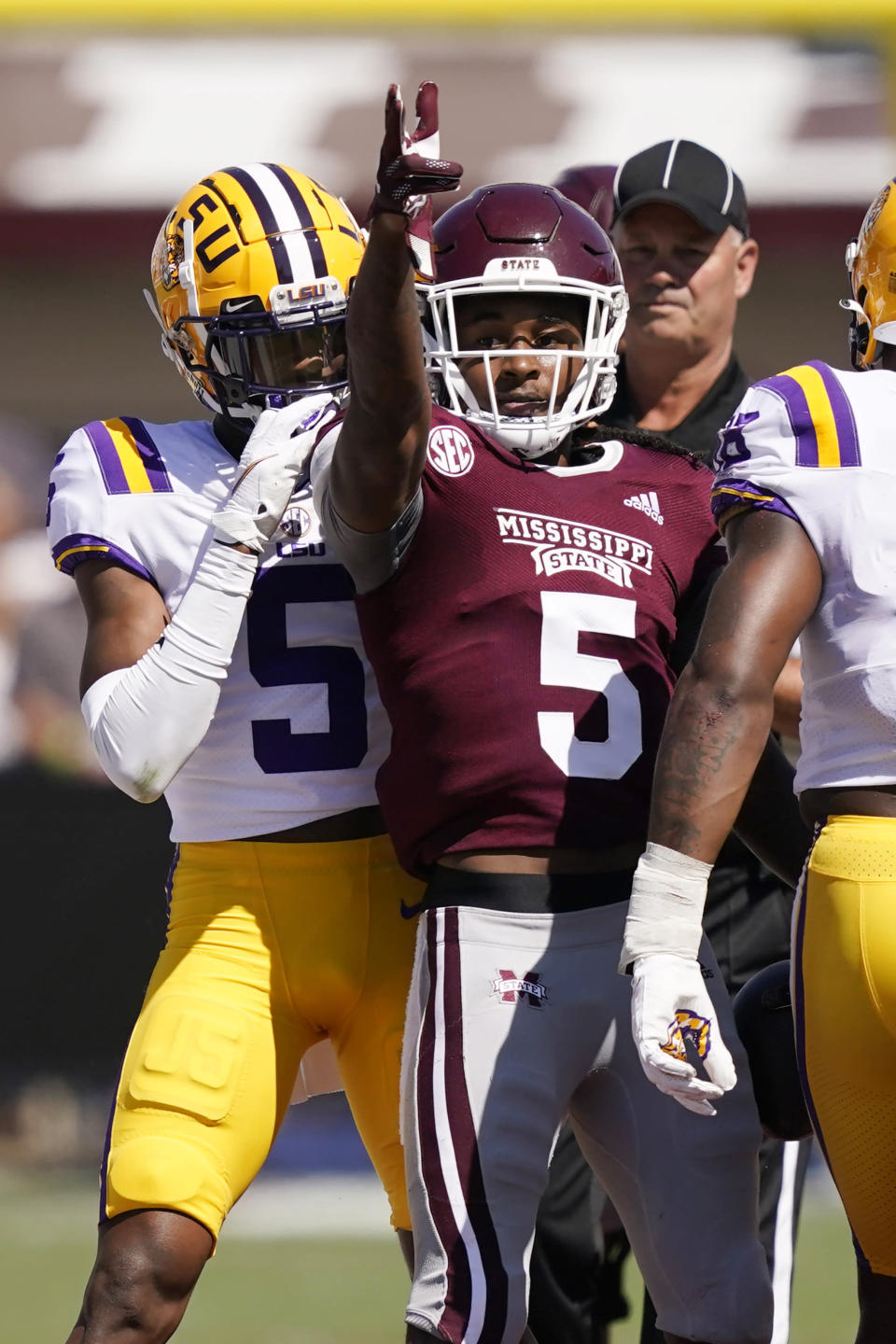 Mississippi State wide receiver Lideatrick Griffin (5) stands amid LSU defenders and gestures after catching a pass for a first down during the first half of an NCAA college football game, Saturday, Sept. 25, 2021, in Starkville, Miss. (AP Photo/Rogelio V. Solis)