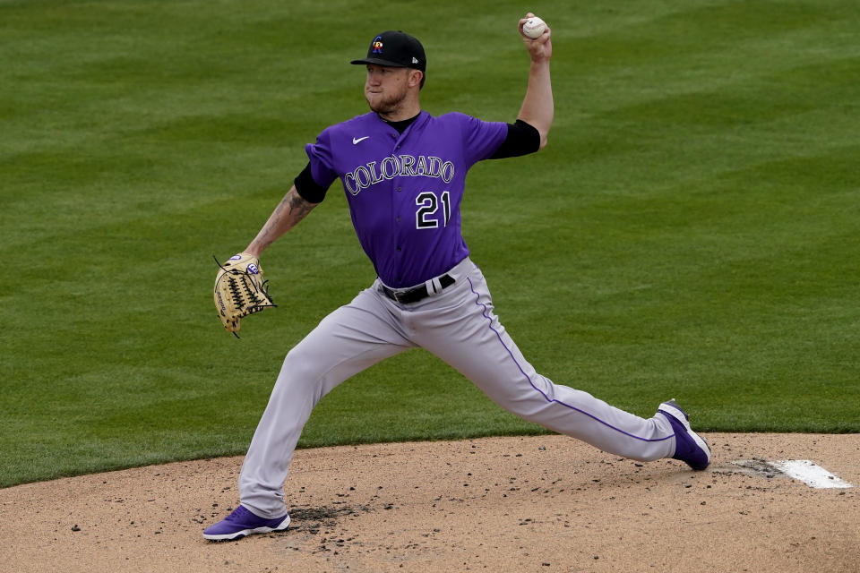Colorado Rockies starting pitcher Kyle Freeland (21) throws against the Oakland Athletics during the first inning of a spring training baseball game, Tuesday, March 23, 2021, in Mesa, Ariz. (AP Photo/Matt York)