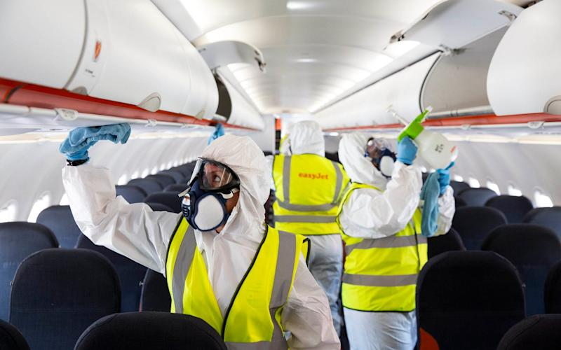 Airline easyJet has introduced new safety and wellbeing measures for customers and crew, which includes enhanced aircraft cleaning and a requirement for passengers and crew to wear face masks when travelling, at Gatwick Airport - Matt Alexander/PA
