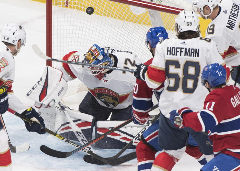 Florida Panthers goaltender Sergei Bobrovsky is scored on by Montreal Canadiens' Tomas Tatar (90) as Panthers' Mike Hoffman (68), Mike Matheson (19) Dominic Toninato (14) and Canadiens' Brendan Gallagher look for the rebound during the second period of an NHL hockey game, Saturday, Feb. 1, 2020 in Montreal. (Graham Hughes/The Canadian Press via AP)