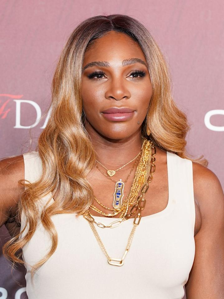 <p>The tennis legend's newly debuted color is one for the books: Glossy honey-blonde with dark roots complements the golden tones in her skin. </p>