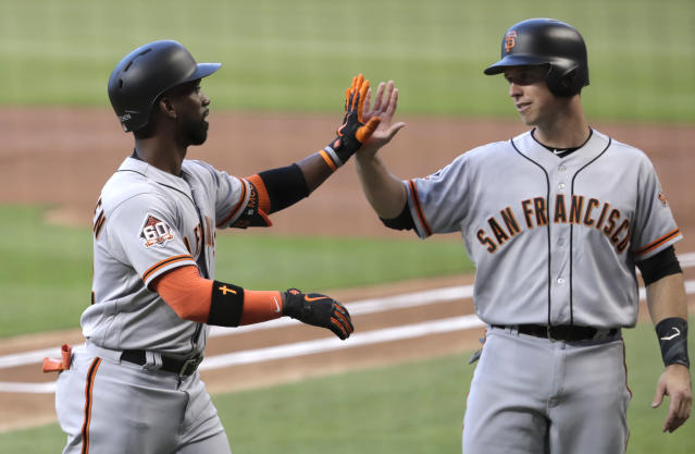 San Francisco Giants' Buster Posey, right, greets Andrew McCutchen after they scored on a home run by McCutchen during the first inning of a baseball game against the Miami Marlins, Wednesday, June 13, 2018, in Miami. (AP Photo/Lynne Sladky)