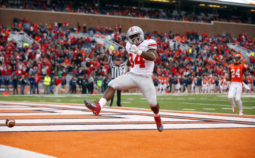 Ohio State running back Carlos Hyde (34) celebrates after scoring on a 51-yard touchdown run during the second half of an NCAA college football game against Illinois on Saturday, Nov. 16, 2013, in Champaign, Ill. Ohio State won the game 60-35. (AP Photo/Jeff Haynes)