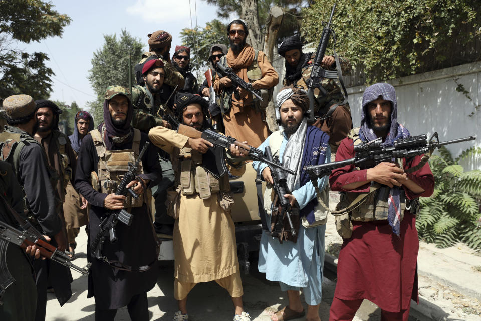 Taliban fighters pose for a photograph in Kabul, Afghanistan, Thursday, Aug. 19, 2021. The Taliban celebrated Afghanistan's Independence Day on Thursday by declaring they beat the United States, but challenges to their rule ranging from running a country severely short on cash and bureaucrats to potentially facing an armed opposition began to emerge. (AP Photo/Rahmat Gul)