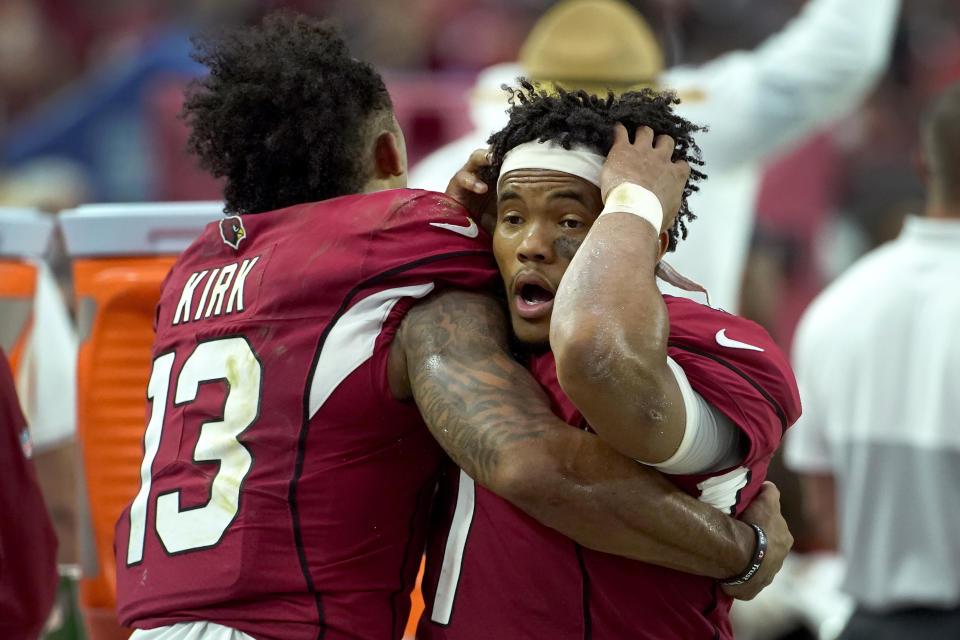 Arizona Cardinals quarterback Kyler Murray reacts with wide receiver Christian Kirk (13) during the final seconds of an NFL football game against the Detroit Lions, Sunday, Sept. 8, 2019, in Glendale, Ariz. The Lions and Cardinals played to a 27-27 tie in overtime. (AP Photo/Rick Scuteri)