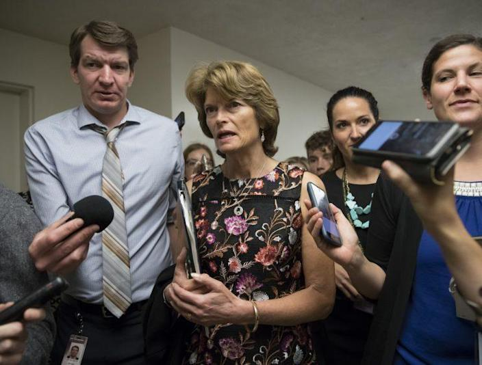 Sen. Lisa Murkowski, R-Alaska, and other lawmakers head to the Senate on July 13 for a meeting on the revised Republican health care bill, which has been under attack from within the party, including Murkowski. (AP Photo/J. Scott Applewhite)