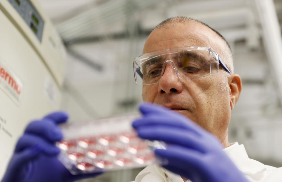Farshad Guirakhoo, Chief Scientific Officer at Smyrna-based GeoVax, checks on one of the vaccine candidates for COVID - 19 that his lab is working on in Smyrna, Ga. on March 17, 2020. The vaccines, while not harmful, contain snippets of COVID - 19 virus DNA. At least a half-dozen efforts are underway in Georgia to research, develop treatments and vaccines for COVID - 19 which currently does not have an FDA approved treatment or vaccine. (Bob Andres/Atlanta Journal-Constitution via AP)