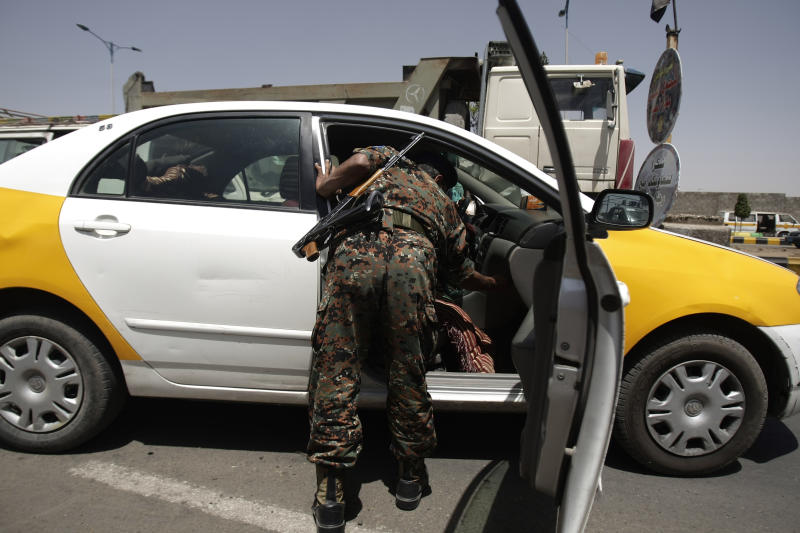 A Yemeni soldier searches a car at a checkpoint in Sanaa, Yemen, Sunday, March 17, 2013. Yemeni police and army troopers are deployed in Sanaa to secure the activities of a national dialogue conference which aims to put the country on the course to full democratic elections next year. (AP Photo/Hani Mohammed)