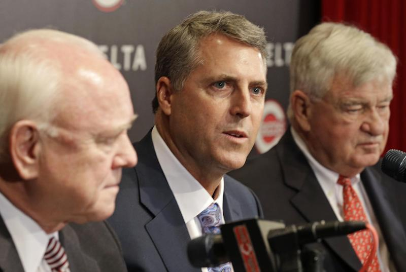 Bryan Price speaks at a news conference with general manager Walt Jocketty, left, and owner Bob Castellini, right, after Price was named manager of the Cincinnati Reds, Tuesday, Oct. 22, 2013, in Cincinnati. Price, who had been the National League baseball team's pitching coach, was signed to a three year contract. Price replaced Dusty Baker. (AP Photo/Al Behrman)