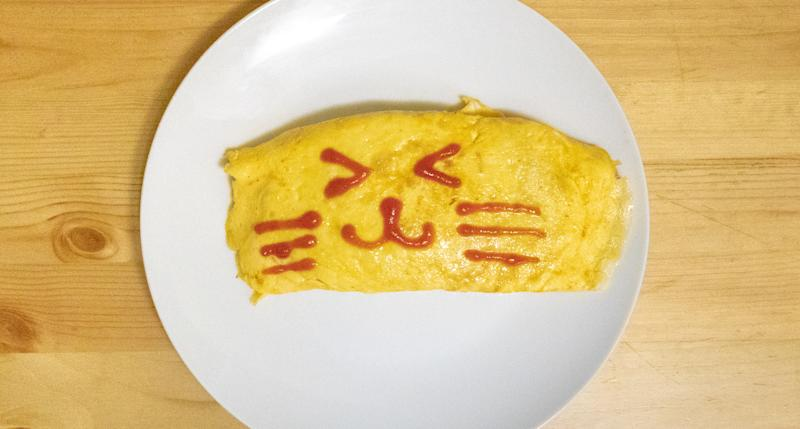 Fried Japanese rice with chicken and coated in ketchup. Topped with an omelet and a nice face. A very popular Japanese dish all over the world.