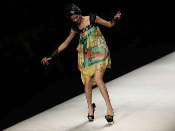 models falling on the runway