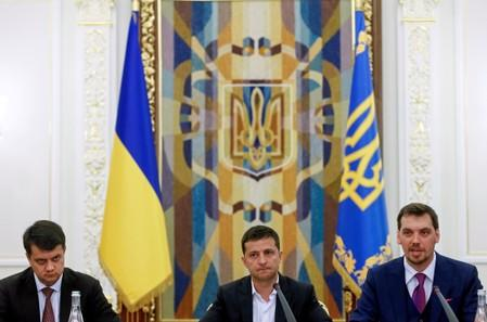 FILE PHOTO: Ukrainian President Zelenskiy, newly-appointed Prime Minister Honcharuk and newly-appointed Parliamentary Speaker Razumkov attend a meeting in Kiev