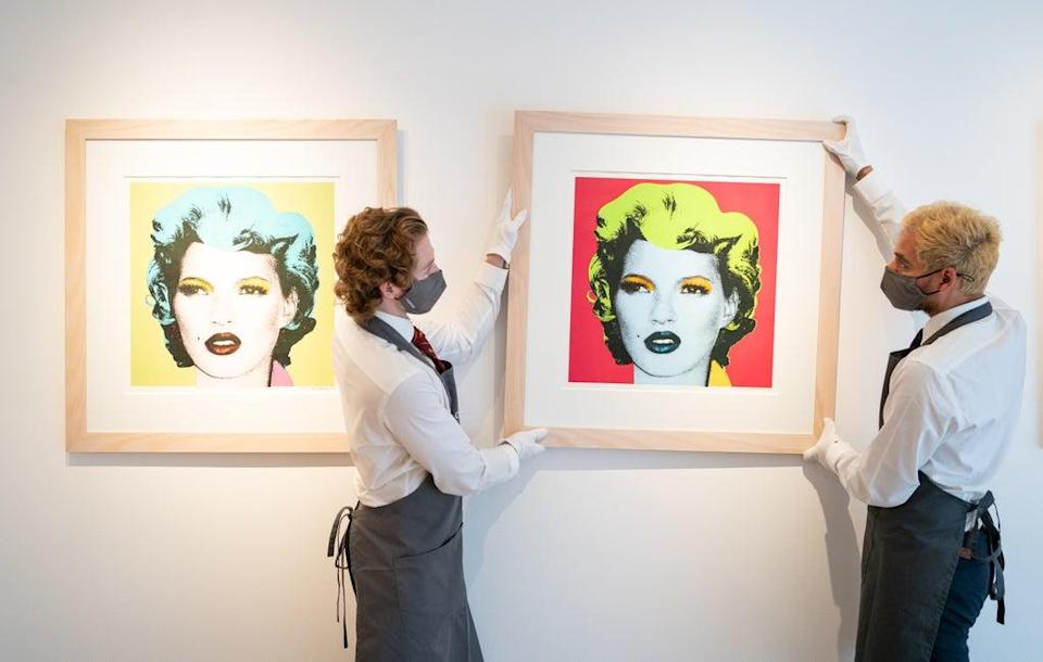 Christie's art handlers adjust prints of Kate Moss by Banksy, which are also included in the sale (Dominic Lipinski/PA) (PA Wire)