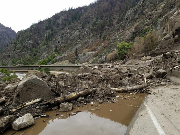 This image provided by the Colorado Department of Transportation shows mud and debris on U.S. Highway 6, Sunday, Aug. 1, 2021 west of Silver Plume, Colo. Mudslides closed some Colorado highways as forecasters warned of potential flash flooding on Sunday across the Rocky Mountain and Great Basin regions. (Colorado Department of Transportation via AP)