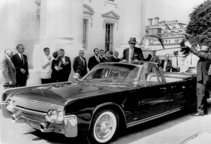 The new custom-built bubble top Lincoln limousine being delivered to the White House for President Kennedy's use, Washington DC, June 1961. It was built to Secret Service specifications and tok five months to construct.