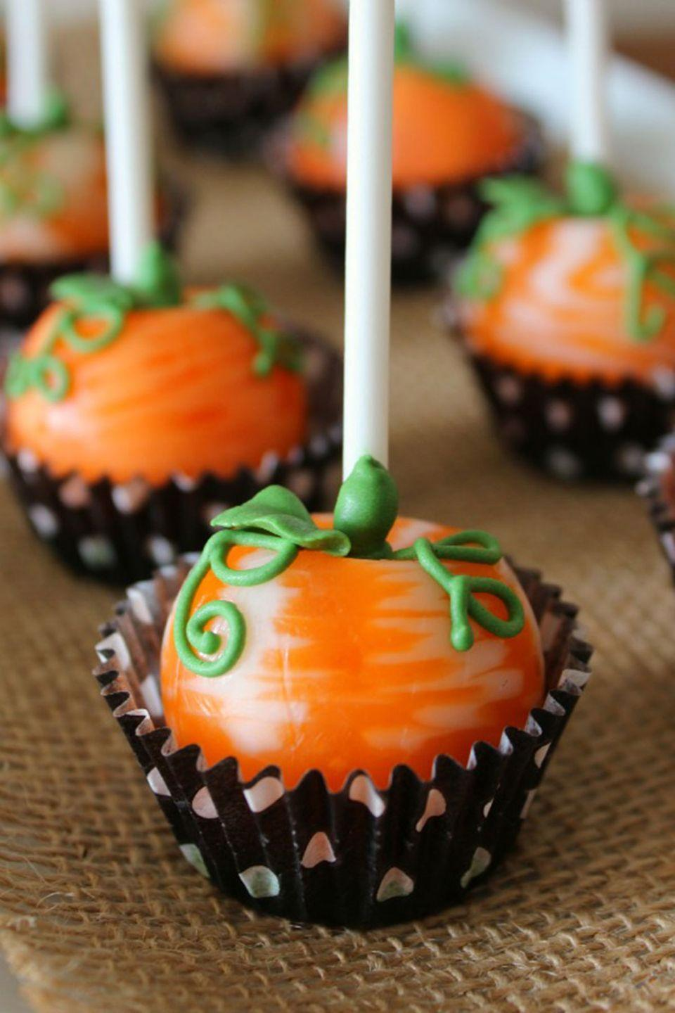 """<p>These pretty pumpkin pops will have you looking like a pro, but they're so easy to make.</p><p><strong>Get the recipe at <a href=""""http://www.sweetsugarbelle.com/2012/09/pumpkin-pops/"""" rel=""""nofollow noopener"""" target=""""_blank"""" data-ylk=""""slk:Sweet Sugarbelle"""" class=""""link rapid-noclick-resp"""">Sweet Sugarbelle</a>. </strong> </p>"""