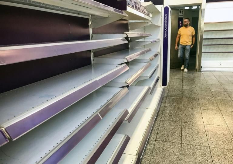 Empty supermarket shelves in Venezuela, which is facing a crippling food shortage