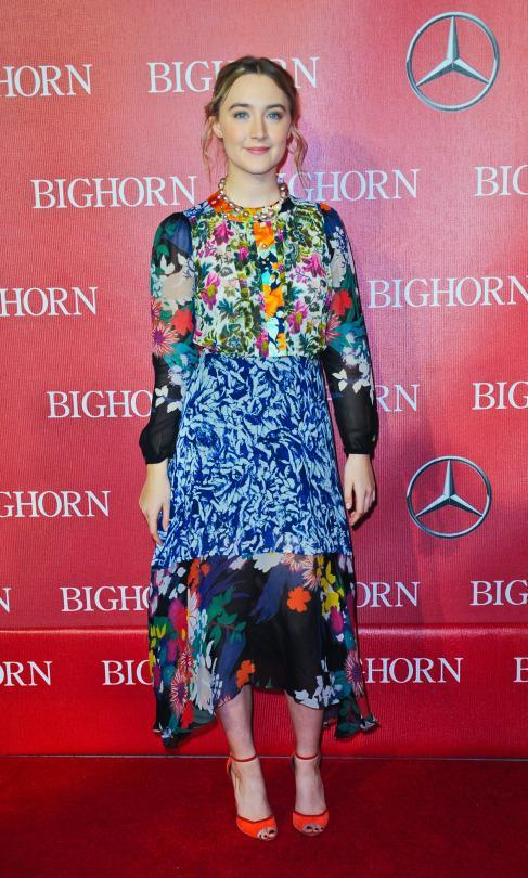 At the 27th Annual Palm Springs International Film Festival Awards, Ronan wears a vibrantly colored, mixed floral-print dress by Nigerian-born designer Duro Olowu. (Photo: Getty)