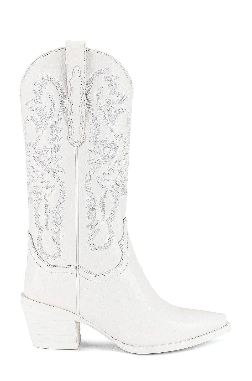 """<br><br><strong>Jeffrey Campbell</strong> Dagget Boot, $, available at <a href=""""https://www.revolve.com/jeffrey-campbell-dagget-boot-in-white-combo/dp/JCAM-WZ1160/?d=Womens&sectionURL=%2Fshoes-boots%2Fbr%2F59da4f%2F%3F%26s%3Dc%26c%3DShoes%26sc%3DBoots%26searchsynonym%3Dcowboy%2Bboots&code=JCAM-WZ1160"""" rel=""""nofollow noopener"""" target=""""_blank"""" data-ylk=""""slk:Revolve"""" class=""""link rapid-noclick-resp"""">Revolve</a>"""