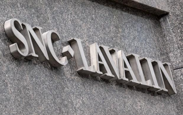 Two former executives with Montreal engineering firm SNC-Lavalin have been charged with various counts of fraud and forgery. The charges are related to bribes that were allegedly paid in exchange for SNC-Lavalin and various subsidiaries obtaining contracts.  (Paul Chiasson/The Canadian Press - image credit)