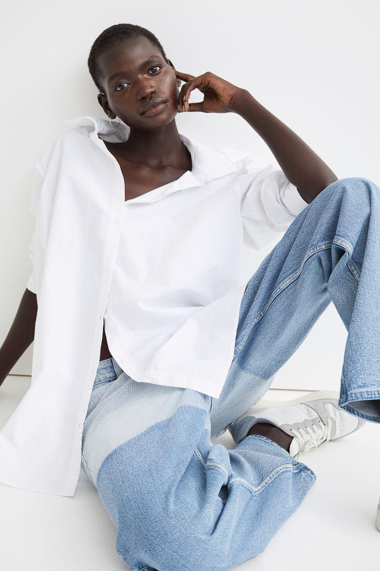 """<h2>H&M White Cotton Shirt</h2><br><strong>The Best Oversized White Button-Down</strong><br>This 100%-cotton style features a straight-cut silhouette with dropped shoulders, a double-layered yoke, slightly front-facing shoulder seams, a box pleat, and a rounded hem with short side slits. Since it's oversized, many reviewers opted to size down for a more streamlined fit while others stuck with their normal sizes for more of a shirt-dress look. <br><br><strong>The Hype:</strong> 4.2 out of 5 stars and 178 reviews on H&M<br><br><strong>What They're Saying: </strong>""""Love love this shirt. In reading many of the reviews, most sized down. I decided to stay with my size and I'm glad I did. It is oversized but it's just the right amount due to the fact that I have long arms and legs even though I'm 5'4 I look taller. The shirt is a little thin which is good during the summer months. Love the color and it compliments the split jeans that I paired them with...got so many compliments. I highly recommend buying.""""<br><br><strong>H&M</strong> Cotton Shirt, $, available at <a href=""""https://go.skimresources.com/?id=30283X879131&url=https%3A%2F%2Fwww2.hm.com%2Fen_us%2Fproductpage.0939581001.html"""" rel=""""nofollow noopener"""" target=""""_blank"""" data-ylk=""""slk:H&M"""" class=""""link rapid-noclick-resp"""">H&M</a>"""