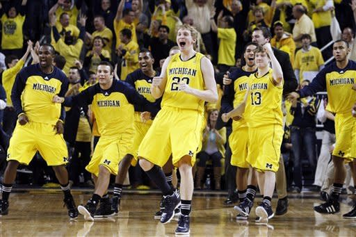 The Michigan bench reacts after their 56-51 win over Ohio State during an NCAA college basketball game in Ann Arbor, Mich., Saturday, Feb. 18, 2012. (AP Photo/Carlos Osorio)