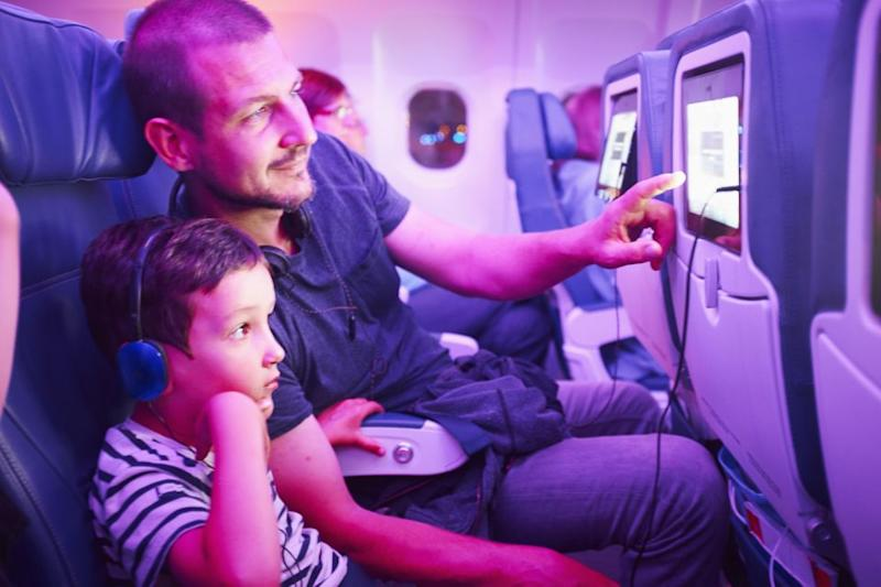 Your days of binge watching flicks on long-haul flights are numbered because some airlines have started to phase out seatback screens. Photo: Getty Images