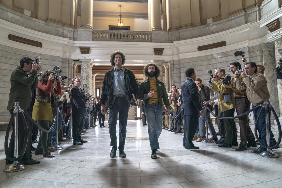 "This image released by Netflix shows Sacha Baron Cohen, center left, and Jeremy Strong in a scene from ""The Trial of the Chicago 7."" (Niko Tavernise/Netflix via AP)"