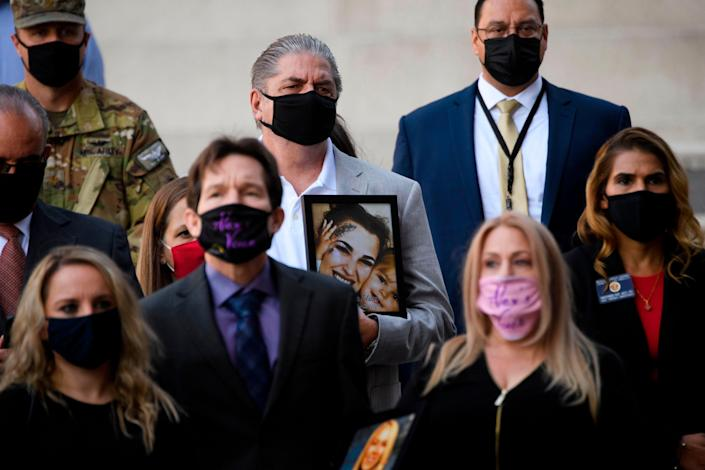 Steve Filson, whose daughter Jessica Filson died in January 2020 of opioids, stands with families who have had relatives die of opioids and authorities during a news conference outside the Roybal Federal Building on February 24, 2021 in Los Angeles, California. (AFP via Getty Images)