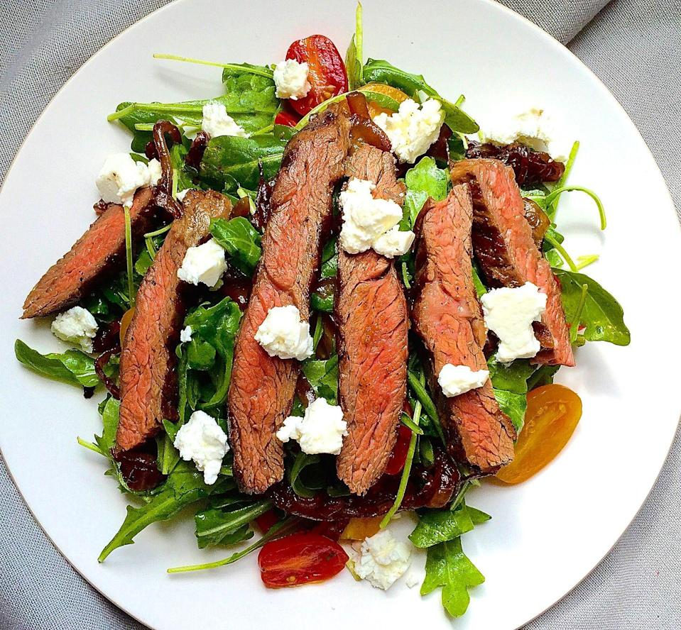 """<p>Tangy feta and Balsamic onions really take the steak.</p><p>Get the recipe from <a href=""""/cooking/recipe-ideas/recipes/a42996/grilled-skirt-steak-salad-arugula-balsamic-glazed-onions-tomatoes-feta/"""" data-ylk=""""slk:Delish"""" class=""""link rapid-noclick-resp"""">Delish</a>.</p>"""