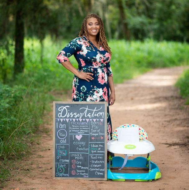 PHOTO: Eve Humphrey poses with her dissertation in a newborn photoshoot spoof after she completed her doctorate in biology at Florida State University in fall 2019. (Korie Mitchell/JessaCole Photography)