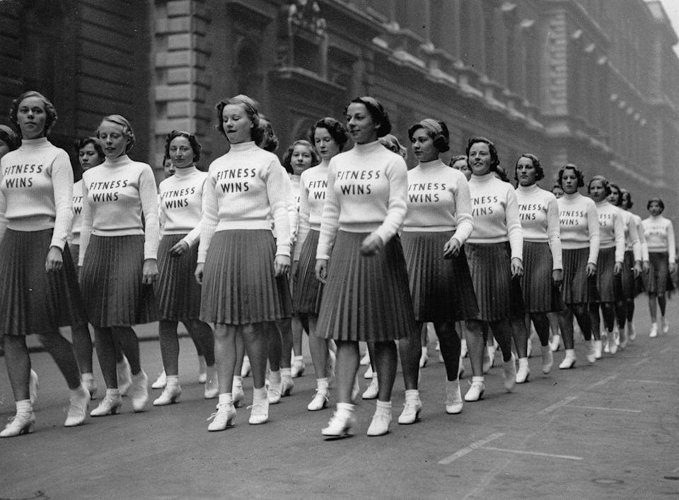 "<p>This Fitness-Parade from 1930 promotes physical education in London. It was in the 1930s that boutique <a href=""https://www.harpersbazaar.com/culture/features/a14626590/history-boutique-fitness/"" rel=""nofollow noopener"" target=""_blank"" data-ylk=""slk:fitness classes"" class=""link rapid-noclick-resp"">fitness classes</a> started to become popular as famous women began to make it trendy to have control over your physical appearance through working out.<br></p>"
