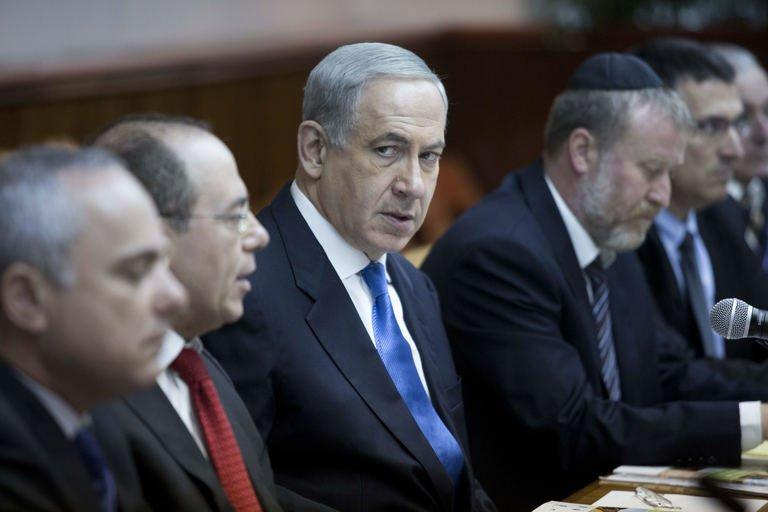 Israeli Prime Minister Benjamin Netanyahu looks over during the weekly cabinet meeting in his Jerusalem office, on July 14, 2013