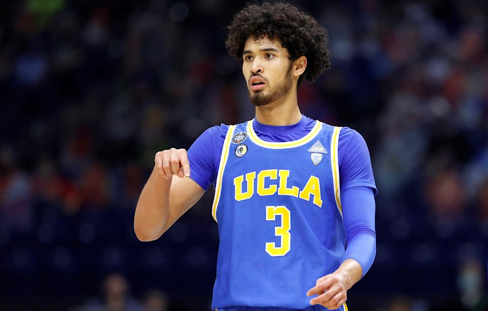 INDIANAPOLIS, INDIANA - APRIL 03: Johnny Juzang #3 of the UCLA Bruins reacts in the first half against the Gonzaga Bulldogs during the 2021 NCAA Final Four semifinal at Lucas Oil Stadium on April 03, 2021 in Indianapolis, Indiana. (Photo by Jamie Squire/Getty Images) ORG XMIT: 775630334 ORIG FILE ID: 1310684551