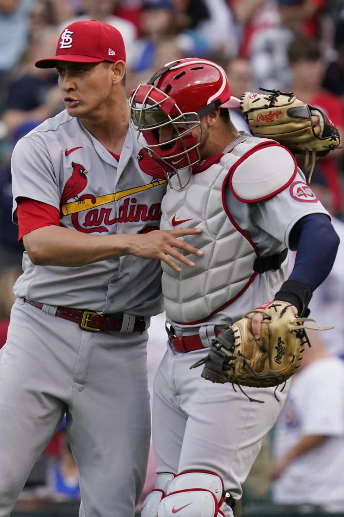 St. Louis Cardinals relief pitcher Giovanny Gallegos, left, celebrates with catcher Andrew Knizner after they defeated the Chicago Cubs in a baseball game in Chicago, Sunday, Sept. 26, 2021. (AP Photo/Nam Y. Huh)