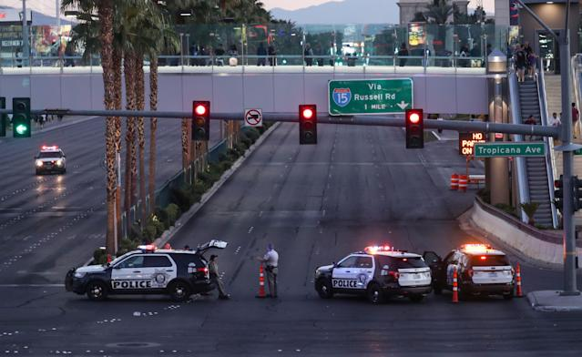 <p>Police block the roads leading to the Mandalay Hotel (background) and inspect the site after a gunman attack in Las Vegas, Nev., on Oct. 2, 2017. (Photo: Bilgin S. Sasmaz/Anadolu Agency/Getty Images) </p>