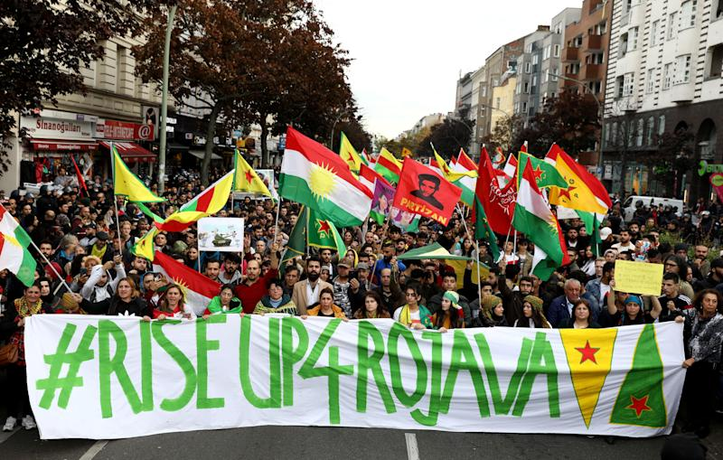Kurdish protesters in Berlin, Germany, carry a banner during a demonstration on Oct. 12 against Turkey's military action in northeastern Syria. (Photo: Christian Mang / Reuters)