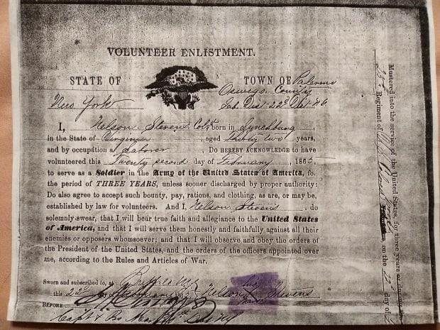 In 1865, Stevens crossed the border in Buffalo. This is a copy of his enlistment paper, which he signed with an X.