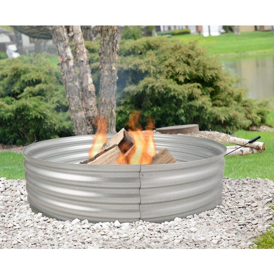 """<p><strong>Pleasant Hearth</strong></p><p>homedepot.com</p><p><strong>$52.26</strong></p><p><a href=""""https://go.redirectingat.com?id=74968X1596630&url=https%3A%2F%2Fwww.homedepot.com%2Fp%2FPleasant-Hearth-Infinity-36-in-x-13-in-Round-Galvanized-Steel-Wood-Fire-Ring-OFW815FR%2F301747084&sref=https%3A%2F%2Fwww.countryliving.com%2Fdiy-crafts%2Fg31966151%2Foutdoor-fireplace-ideas%2F"""" rel=""""nofollow noopener"""" target=""""_blank"""" data-ylk=""""slk:Shop Now"""" class=""""link rapid-noclick-resp"""">Shop Now</a></p><p>This simple and durable design is a great choice for the budget-conscious shopper.</p>"""