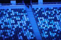 <p>A view shows empty seats in the stadium during the opening ceremony of the Tokyo 2020 Olympic Games, at the Olympic Stadium in Tokyo, on July 23, 2021. (Photo by Leon Neal / POOL / AFP) (Photo by LEON NEAL/POOL/AFP via Getty Images)</p>