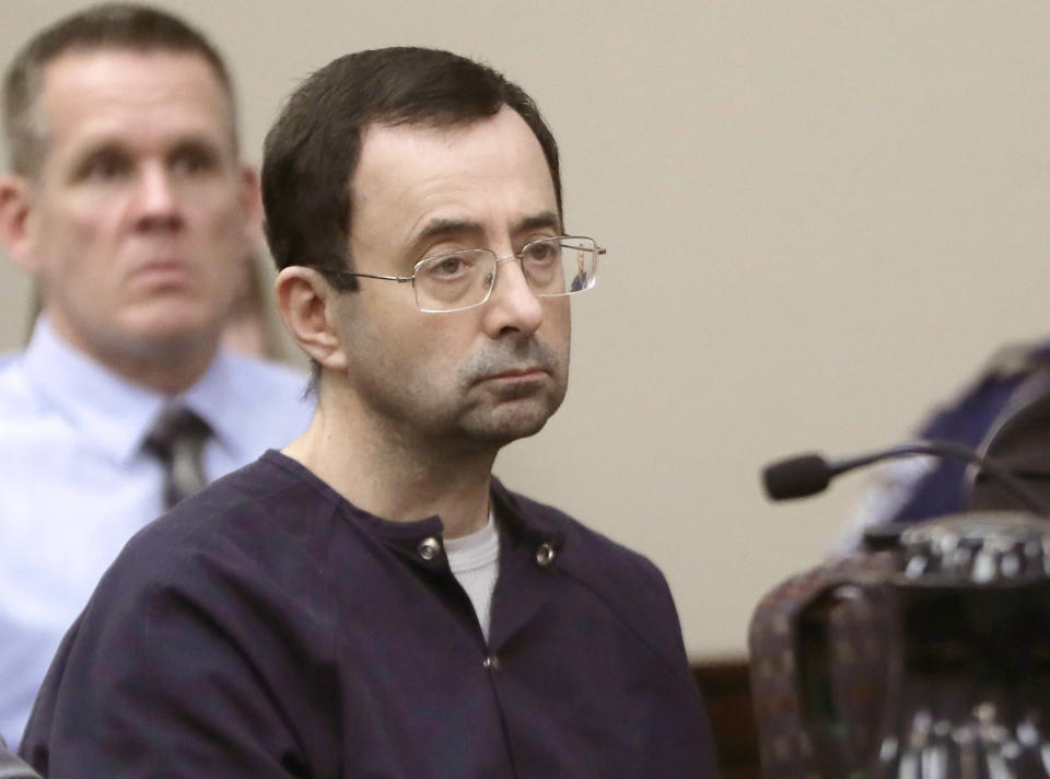 """FILE - In this Jan. 24, 2018, file photo, Larry Nassar, a former doctor for USA Gymnastics and member of Michigan State's sports medicine staff, sits in court during his sentencing hearing in Lansing, Mich. The FBI made numerous serious errors in investigating allegations against former USA Gymnastics national team doctor Larry Nassar and didn't treat the case with the """"utmost seriousness,"""" the Justice Department's inspector general said Wednesday, July 24, 2021. The FBI acknowledged conduct that was """"inexcusable and a discredit"""