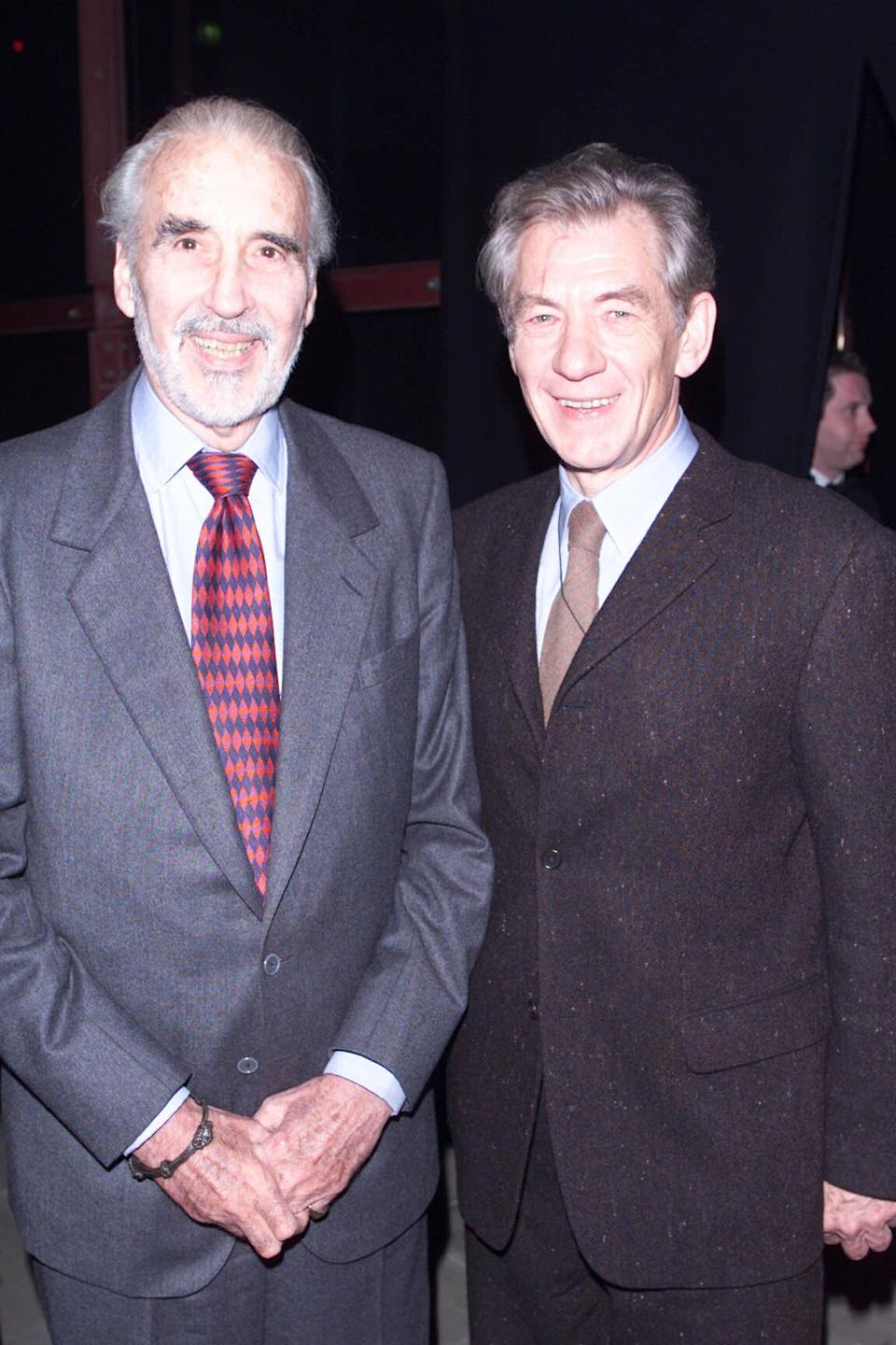 """LONDON - DECEMBER 11: British actor Christopher Lee and Ian McKellen attend the premiere party for the film """"Lord of the Rings: The Fellowship of the Ring"""" at Tobacco Dock on December 11, 2001 in London. (Photo by Dave Hogan/Getty Images)"""