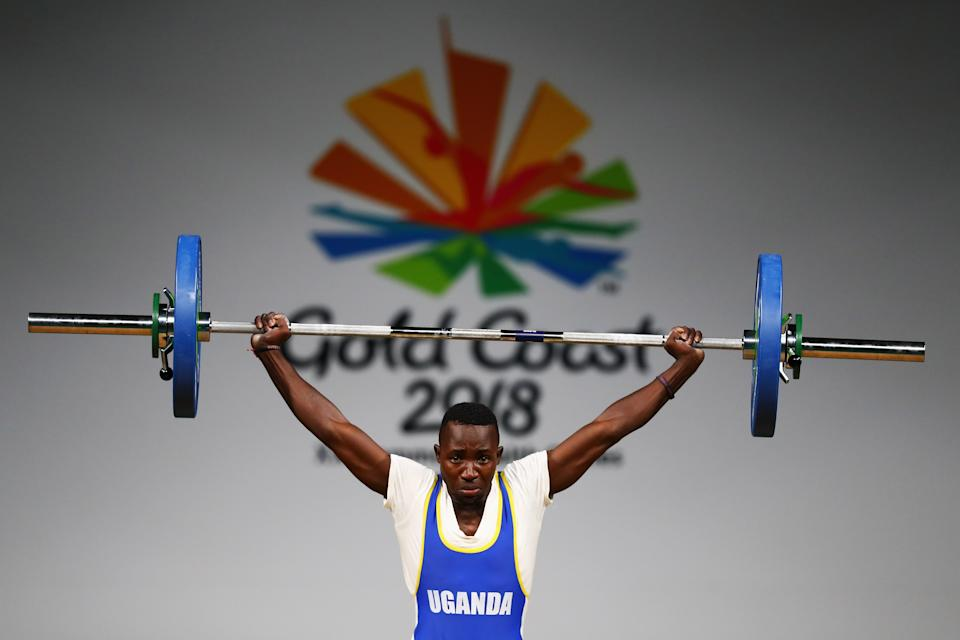 GOLD COAST, AUSTRALIA - APRIL 05:  Julius Ssekitoleko of Uganda competes during the Weightlifting Men's 56kg Final on day one of the Gold Coast 2018 Commonwealth Games at Carrara Sports and Leisure Centre on April 5, 2018 on the Gold Coast, Australia.  (Photo by Dean Mouhtaropoulos/Getty Images)