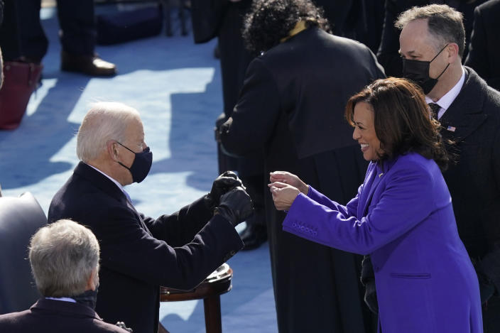 President-elect Joe Biden congratulates Vice President Kamala Harris after she was sworn in during the 59th Presidential Inauguration at the U.S. Capitol in Washington, Wednesday, Jan. 20, 2021. (AP Photo/Carolyn Kaster)